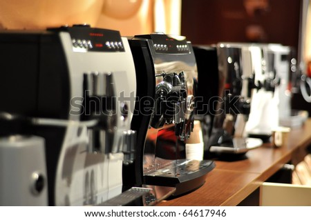Espresso cappuccino coffee machine on the table - stock photo