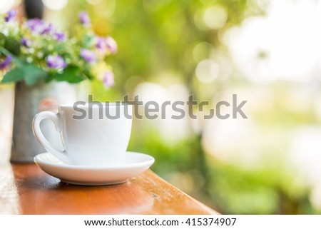 espresso coffee cup on wooden table ,soft focus - stock photo