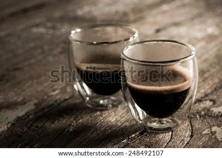 Espresso coffee, double wall glass. - stock photo