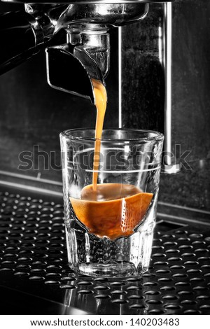 Espresso coffee extraction with a professional machine - stock photo