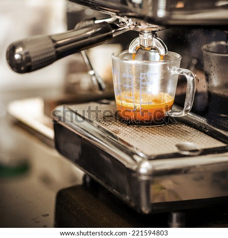 Espresso coffee machine in vintage backgrounds - stock photo