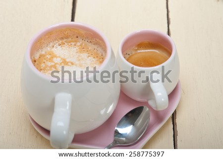 espresso coffee  served on a pink heart shaped dish - stock photo
