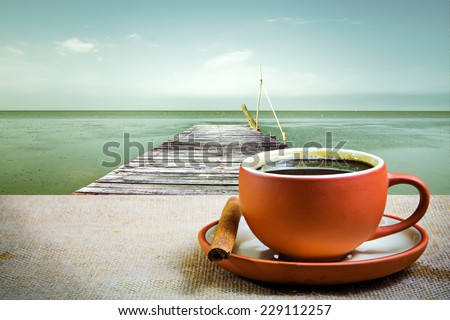 Espresso coffee with pier and sea background  - stock photo