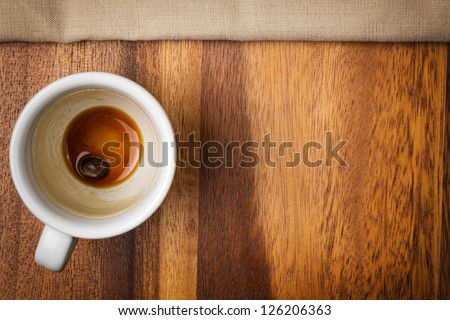 espresso cup on wood surface with space - stock photo