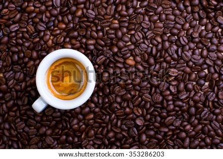 espresso cup with a lot of coffee beans - stock photo