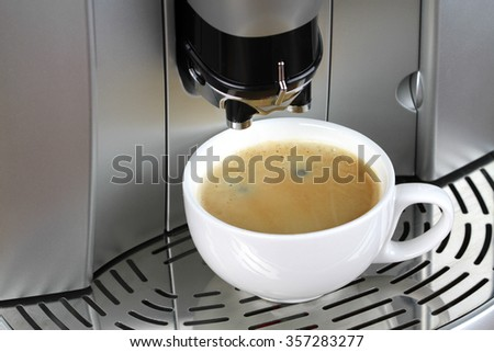Espresso machine and a cup of coffee - stock photo