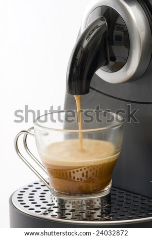 Espresso machine dispensing coffee into a glass cup - stock photo