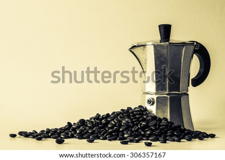 Espresso pot and coffee beans with vintage style - stock photo