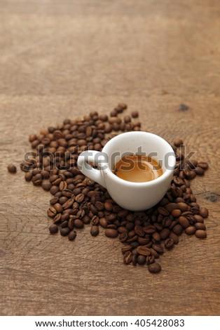 Espresso with Coffee Beans - stock photo