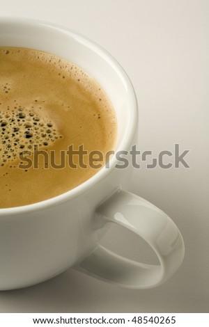 Espresso with crema isolated on  white - stock photo