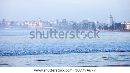 Essaouira , Morocco.  City and Wilaya  in  mist  at sunset. View from the beach - stock photo