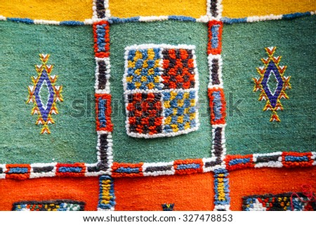 ESSAOUIRA, MOROCCO, SEPTEMBER 13: Details of bright colorful carpet at a market stall in Fez, Morocco 2006 - stock photo