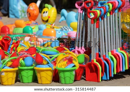 essential beach plastic tools for kids in outdoor shop - stock photo