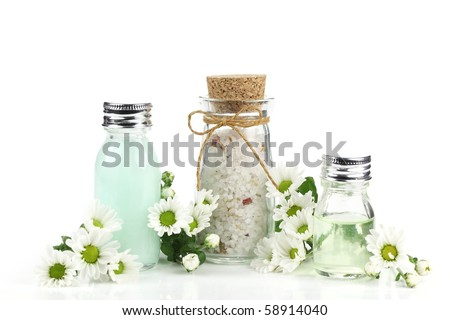 Essential oil and bath salt over white - stock photo