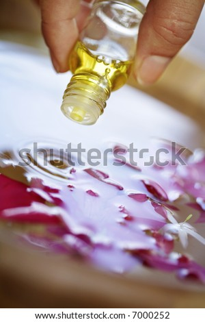 essential oil being applyed to water - stock photo