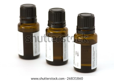 essential oil bottles, isolated - stock photo