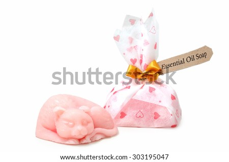 Essential oil soap and cat shape isolate on white for souvenir - stock photo