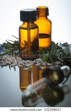essential oil with herbs - stock photo