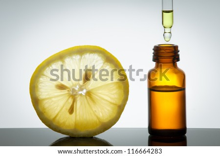 Essential oil with lemon - stock photo