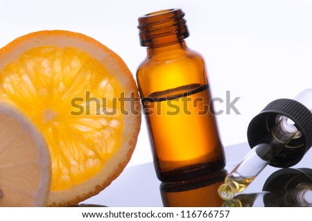 Essential oil with lemon and orange - stock photo