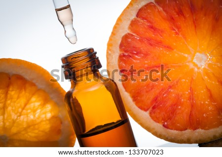 Essential oil with oranges - stock photo