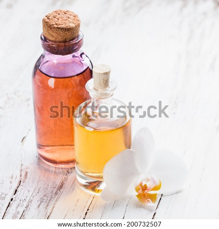 essential oil with orchid flower - spa concept - stock photo