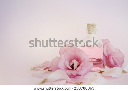 Essential oil with petals - stock photo