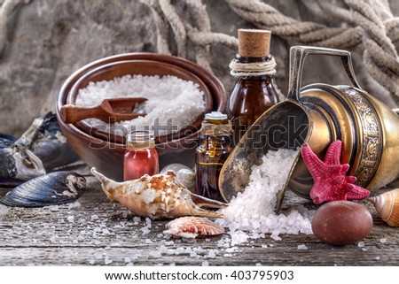 Essential oils and bath salt with a sea shells - stock photo