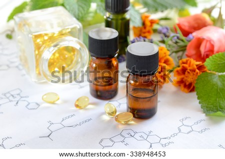 essential oils and supplement with herbs in science sheet - stock photo