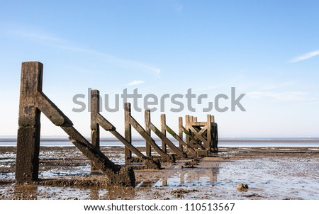 Essex UK Southend low tide at ruins of old garrison pier - stock photo