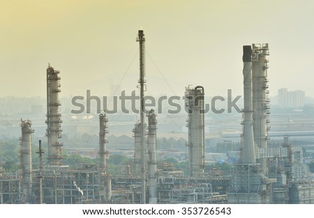 Esso Oil refinery- December 14,2015 , Petrochemical industrial with city background at sunset in Si Racha District, Chon Buri , Thailand - stock photo
