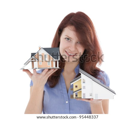 Estate agency client choose new house represented by model. Real estate agent helps select house. - stock photo