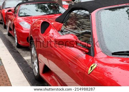 ESTEPONA, SPAIN - MAR 16: Ferrari supercars parked in the street of Estepona. March 16, 2013 in Estepona, Costa del Sol, Andalusia, Spain - stock photo