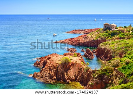 Esterel mediterranean red rocks coast, beach and sea. French Riviera in Cote d Azur near Cannes, Provence, France, Europe. - stock photo