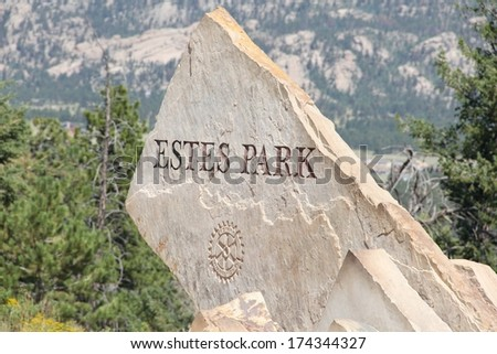 ESTES PARK, COLORADO/U.S.A.-AUGUST 8, 2011:  Stone, entrance sign to the high mountain village of Estes Park.  Located 7,522 feet above sea level, surrounded by snow capped peaks, discovered in 1859. - stock photo
