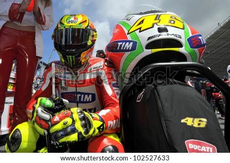 ESTORIL, PORTUGAL - MAY 6: Ducati team Valentino Rossi in the grid of MotoGP,  May 6, 2012 in Estoril, Portugal - stock photo