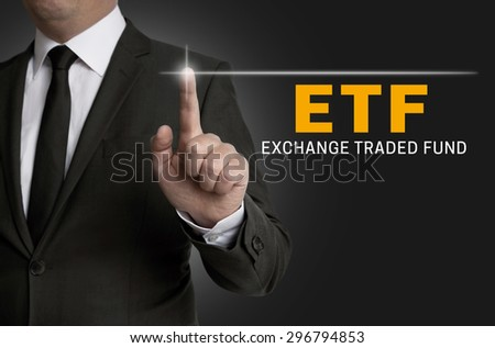 ETF touchscreen is operated by businessman. - stock photo