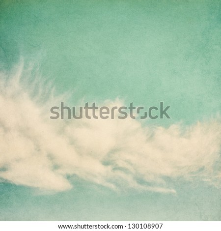 Ethereal and puffy clouds on a vintage paper background.  Image has a pleasing paper grain and texture. - stock photo