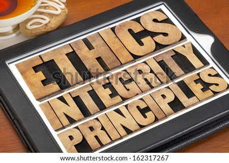 ethics, integrity and principles word abstract - ethical concept on a digital tablet with a cup of tea - stock photo