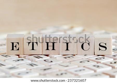 ethics word background on wood blocks - stock photo
