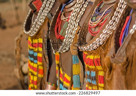 Ethiopia, close up of women's dresses from Hamer tribe - stock photo