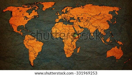 ethiopia flag on old vintage world map with national borders - stock photo