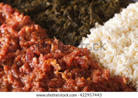 Ethiopian cuisine: kitfo with herbs and cheese a macro. horizontal background