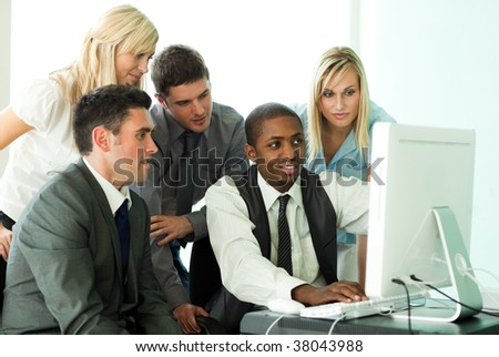 Ethnic business team working in office together - stock photo