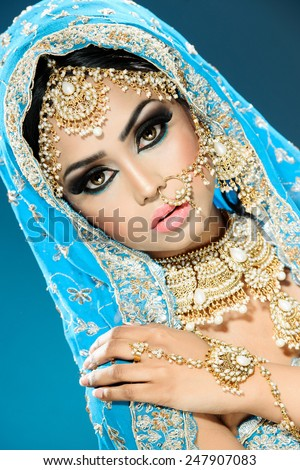 Ethnic Eastern bride in bollywood style bridal outfit - stock photo