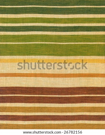 Ethnic fabric with pattern of coloured stripes - stock photo