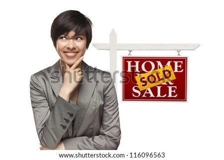Ethnic Woman in Front of Sold Home For Sale Real Estate Sign Isolated on a White Background. - stock photo