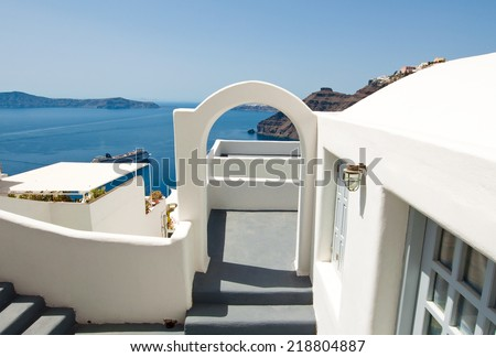 Etrance to the caved house with patio in Fira town on the Santorini (Thira) island in Greece. - stock photo