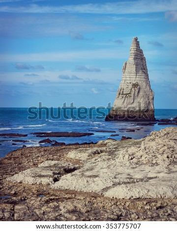 Etretat steep arch shaped cliff at low tide, Normandy, France - stock photo