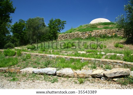 Etruscan crypt on the hill - stock photo